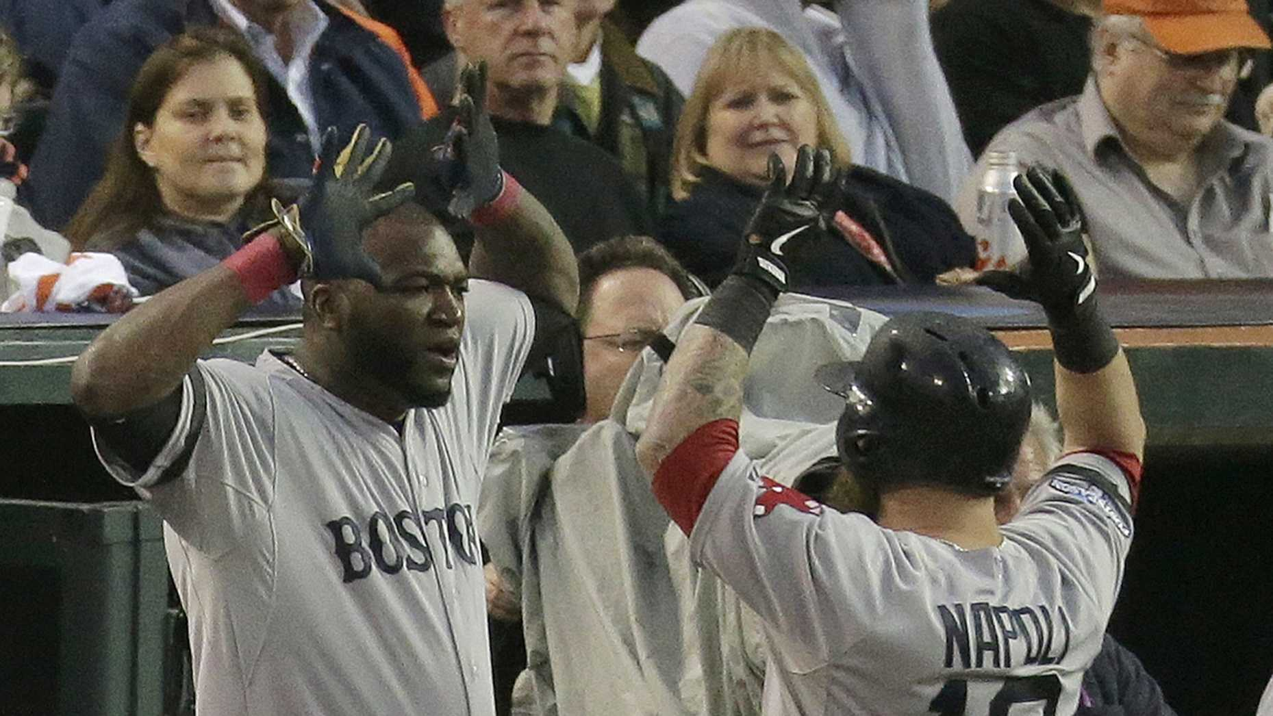 Boston Red Sox's David Ortiz congratulates Mike Napoli after Napoli hits a home run in the seventh inning during Game 3 of the American League baseball championship series against the Detroit Tigers Tuesday, Oct. 15, 2013, in Detroit.