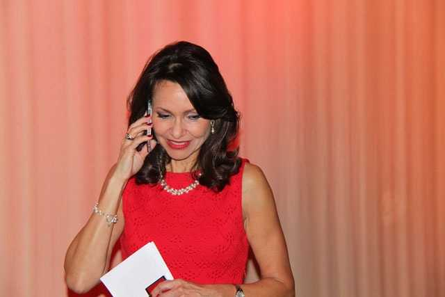 Liz, who is leaving for her new venture: Liz Brunner Communications, takes a last-minute phone call before the celebration begins.