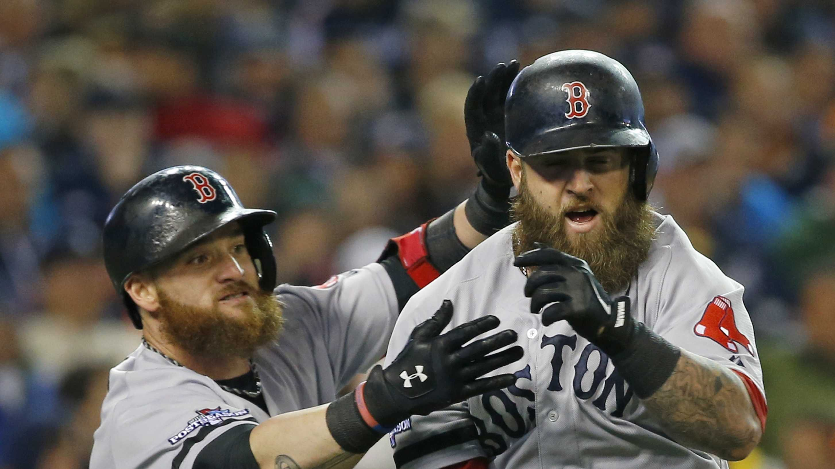 Boston Red Sox's Mike Napoli, right, is greeted by Jonny Gomes following a home run by Napoli in the second inning during Game 5 of the American League baseball championship series against the Detroit Tigers, Oct. 17, 2013, in Detroit.