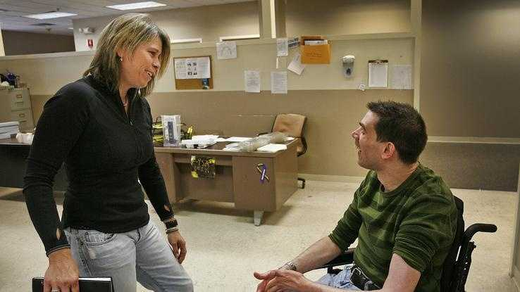 Patty Garrity chats with her brother Mark, a Weymouth native, at the Road to Responsibility work center in Braintree on Monday Oct. 7, 2013.