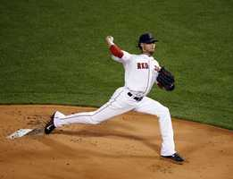 Boston Red Sox starting pitcher Clay Buchholz throws in the first inning.