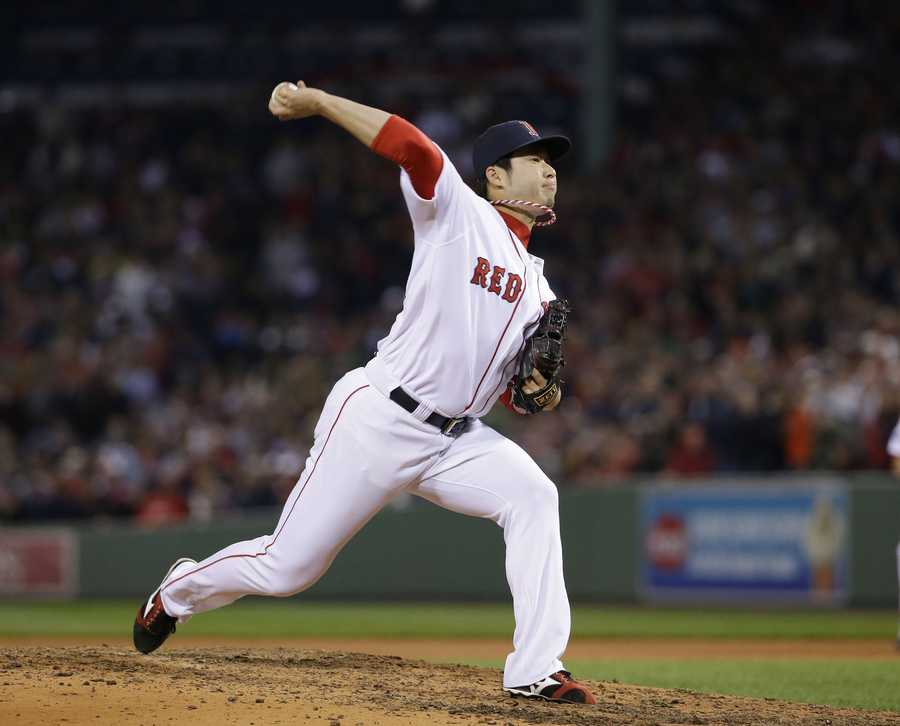 Boston Red Sox relief pitcher Junichi Tazawa throws against the Detroit Tigers in the seventh inning.