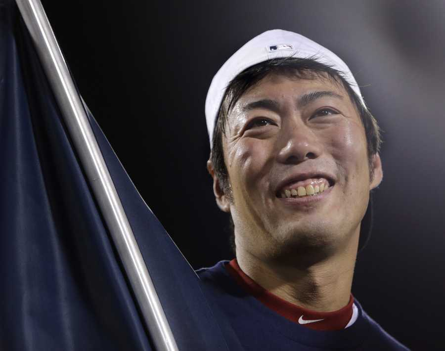 Boston Red Sox relief pitcher Koji Uehara smiles after the Red Sox beat the Detroit Tigers 5-2 in Game 6 of the American League baseball championship series on Saturday, Oct. 19, 2013, in Boston. Uehara was named the series' most valuable player, and the Red Sox advance to the World Series.