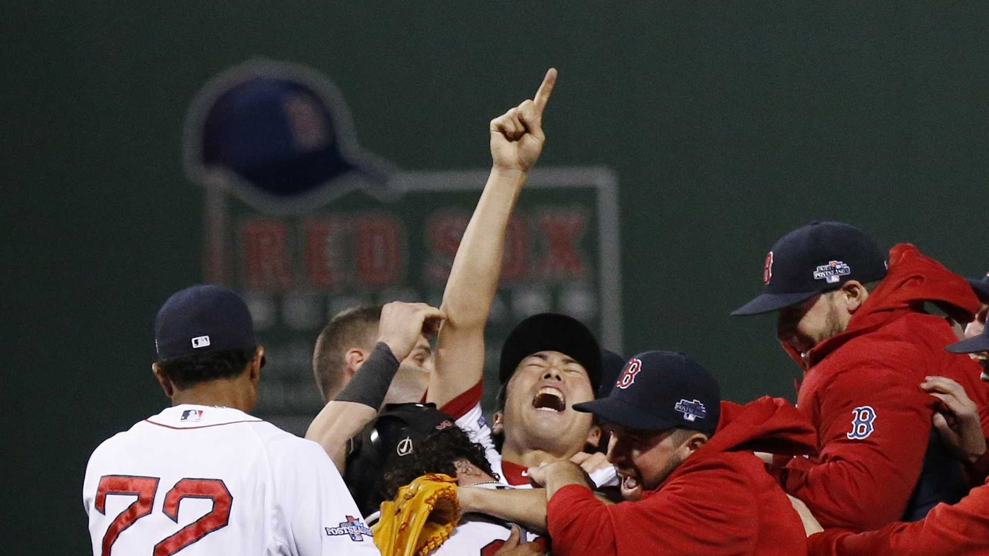 Boston Red Sox relief pitcher Koji Uehara, center, celebrates with teammates after the Red Sox 5-2 beat the Detroit Tigers in Game 6 of the American League baseball championship series on Saturday, Oct. 19, 2013, in Boston. The Red Sox advance to the World Series.