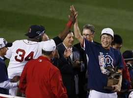 Boston Red Sox relief pitcher Koji Uehara, right, gets a high five from David Ortiz after the Red Sox beat the Detroit Tigers 5-2 in Game 6 of the American League baseball championship series on Saturday, Oct. 19, 2013, in Boston. Uehara was named the series MVP, and the Red Sox advance to the World Series.