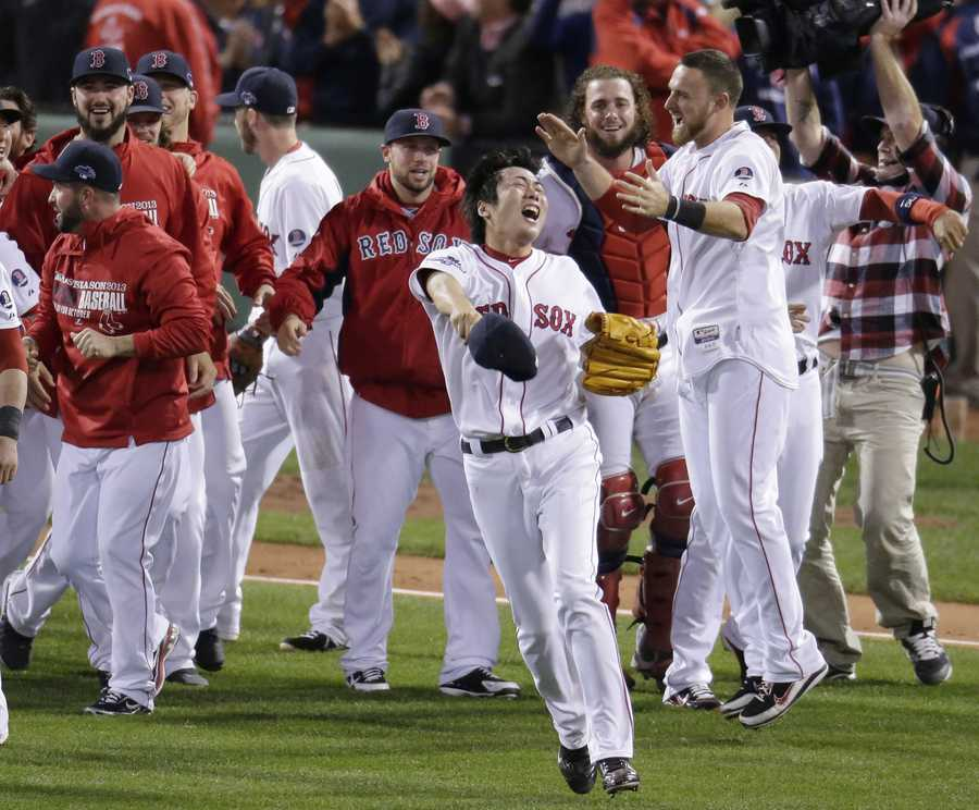 Boston Red Sox relief pitcher Koji Uehara, front, celebrates with teammates after the Red Sox beat the Detroit Tigers 5-2 in Game 6 of the American League baseball championship series on Saturday, Oct. 19, 2013, in Boston. Uehara was named the series' most valuable player, and the Red Sox advance to the World Series.