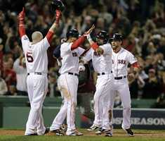 Boston Red Sox's Shane Victorino, second from right, celebrates his grand slam with Jonny Gomes, left, Xander Bogaerts, second from left, and Jacoby Ellsbury, right, in the seventh inning during Game 6 of the American League baseball championship series against the Detroit Tigers on Saturday, Oct. 19, 2013, in Boston.