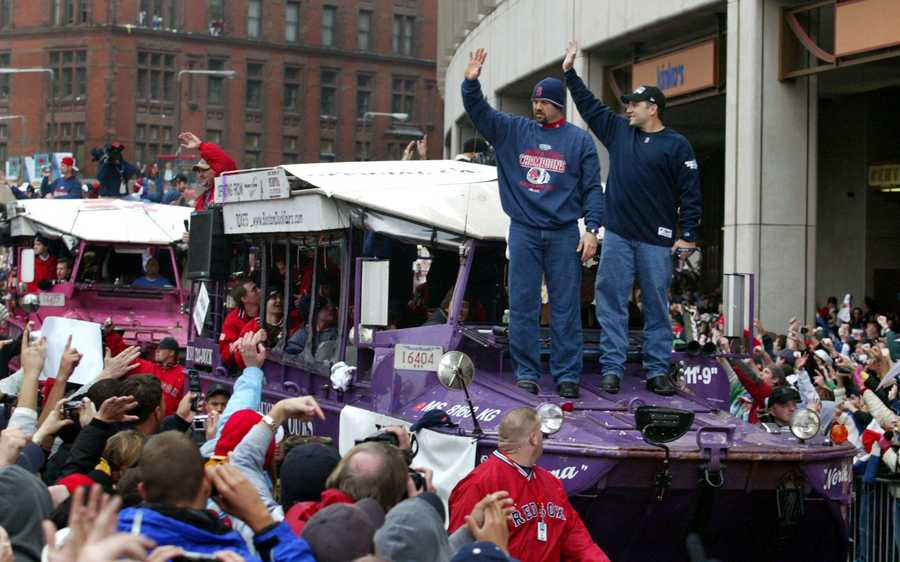 Boston Red Sox catchers Jason Varitek, left, and Doug Mirabelli, acknowledge the crowd during the Boston Red Sox's victory parade, Saturday, Oct, 30, 2004 in Boston. Hundreds of thousands of Red Sox fans jammed streets and the banks of the Charles River on Saturday to watch a parade many had begun to doubt they would ever witness: a toast to a World Series champion team.