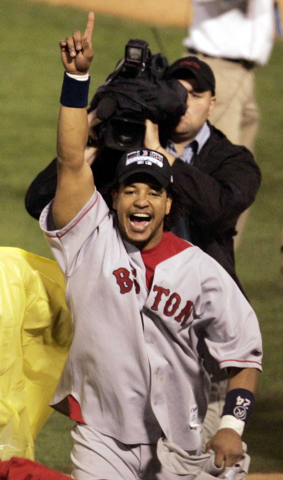 Boston Red Sox's Manny Ramirez, the World Series MVP, celebrates after Boston beat the St. Louis Cardials 3-0 in Game 4 to win the World Series Wednesday, Oct. 27, 2004, in St. Louis. Ramirez was name MVP of the Series.