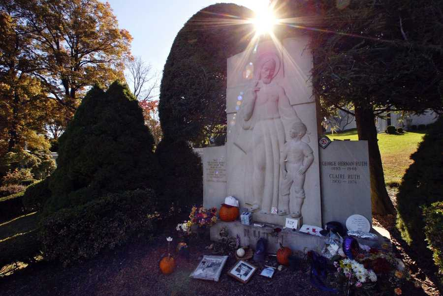 """The grave of George Herman 'Babe'' Ruth is decorated with items left by New York Yankees and Boston Red Sox fans, Thursday, Oct. 28, 2004 in Hawthorne. The """"Curse of the Bambino"""" has followed Boston through four World Series defeats, each one in seven games. The end of the drought came Wednesday, Oct. 27, when Boston completed a sweep of the St. Louis Cardinals to win the World Series."""