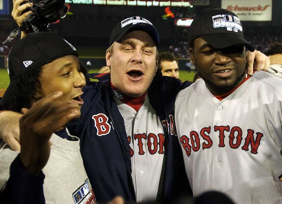 Boston Red Sox players, left to right, Pedro Martinez, Curt Schilling and David Ortiz celebrate after the Red Sox defeated the St. Louis Caridnals 3-0 in Game 4 to win the World Series at Busch Stadium in St. Louis, Wednesday, Oct. 27, 2004.