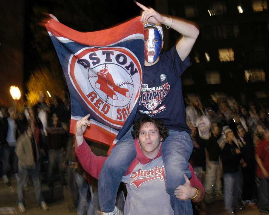 People at the University of Massachusetts campus in Amherst, Mass., celebrate early Thursday, Oct. 28, 2004, after the Boston Red Sox defeated the St. Louis Cardinals 3-0 to complete a sweep in the World Series.