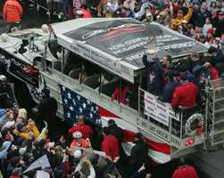 Boston Red Sox David McCarty holds up the World Series trophy as he passes fans during the Red Sox World Series Championship parade through the streets of Boston, Saturday Oct. 30, 2004.