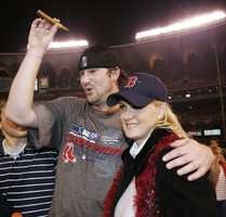Boston Red Sox pitcher Derek Lowe celebrates with his wife, Trinka, after the Red Sox beat the St. Louis Cardinals 3-0 to win the World Series Wednesday, Oct. 27, 2004, in St. Louis. Lowe was the winning pitcher.