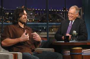 """Johnny Damon of the Boston Red Sox talks with Late Show host David Letterman about Boston finally winning the Baseball World Series during the taping of the """"Late Show with David Letterman,"""" Monday, Nov. 1, 2004, in New York."""