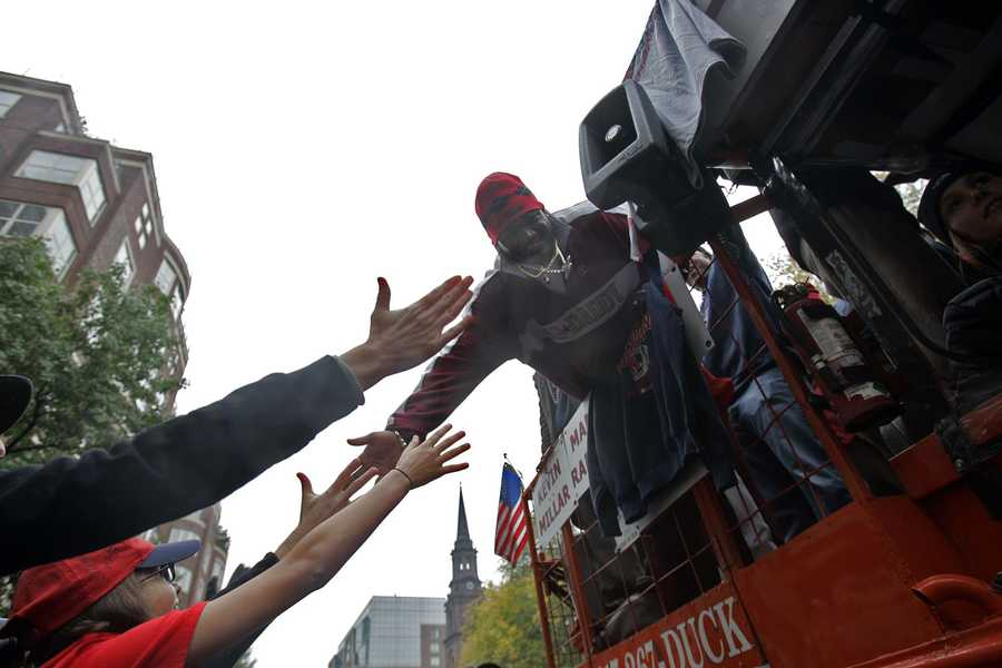 Boston Red Sox David Ortiz slaps hands with fans as the parade of duck boats ride along Boylston Street in Boston, Saturday, Oct 30, 2004. Hundreds of thousands of Red Sox fans jammed streets and the banks of the Charles River on Saturday to watch a parade many had begun to doubt they would ever witness: a toast to a World Series champion team.