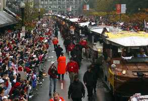 Boston Red Sox fans cheer for their team as the Red Sox World Series Championship parade rolls by in Boston Saturday, Oct. 30, 2004.