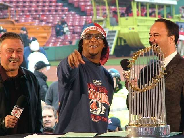 Pedro Martinez with Red Sox broadcasters Jerry Remy and Don Orsillo at Fenway Park with the World Series trophy.