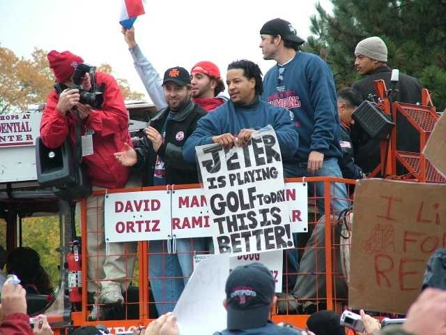 Kevin Millar and Manny Ramirez in a duck boat along the parade route.