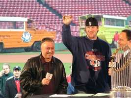 Red Sox pitcher Derek Lowe with Jerry Remy and Don Orsillo at Fenway Park with the World Series trophy.