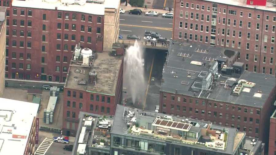 Water sprayed up to 60 feet in the air after a water main broke in Boston's Fort Point section Wednesday afternoon.