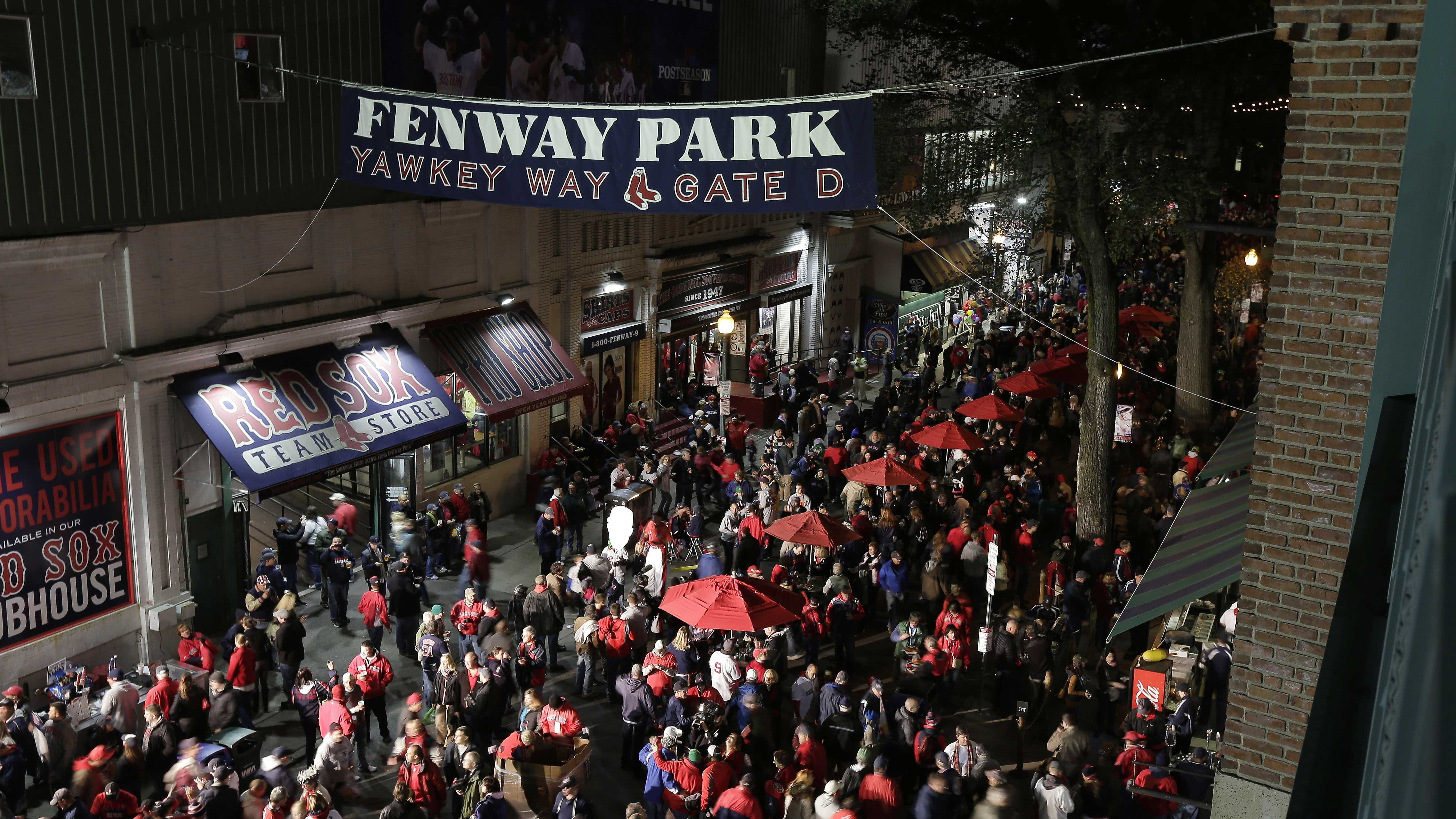Fans make their way to Fenway Park before Game 1 of baseball's World Series between the Boston Red Sox and the St. Louis Cardinals Wednesday, Oct. 23, 2013, in Boston.