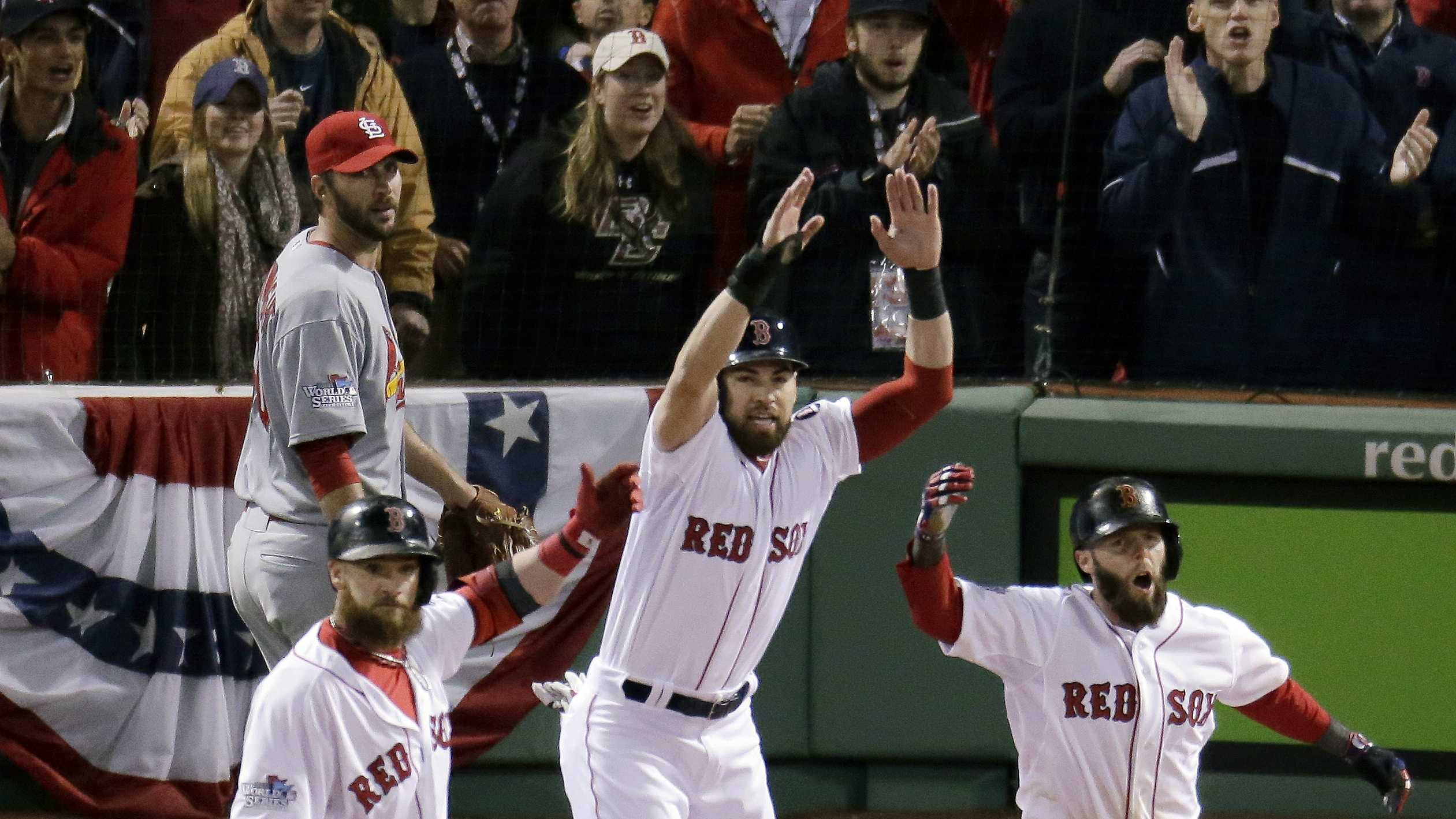 St. Louis Cardinals starting pitcher Adam Wainwright, left, rear watches as Boston Red Sox's Jonny Gomes, left, Jacoby Ellsbury, center, and Dustin Pedroia, celebrate a three-run scoring double by Mike Napoli during the first inning of Game 1 of baseball's World Series Wednesday, Oct. 23, 2013, in Boston.