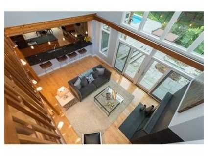 It has an open living room with double-sided fireplace, lounge with bar, & formal dining room.