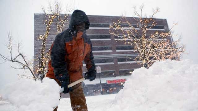 Snow man shovels heavy snow.jpg