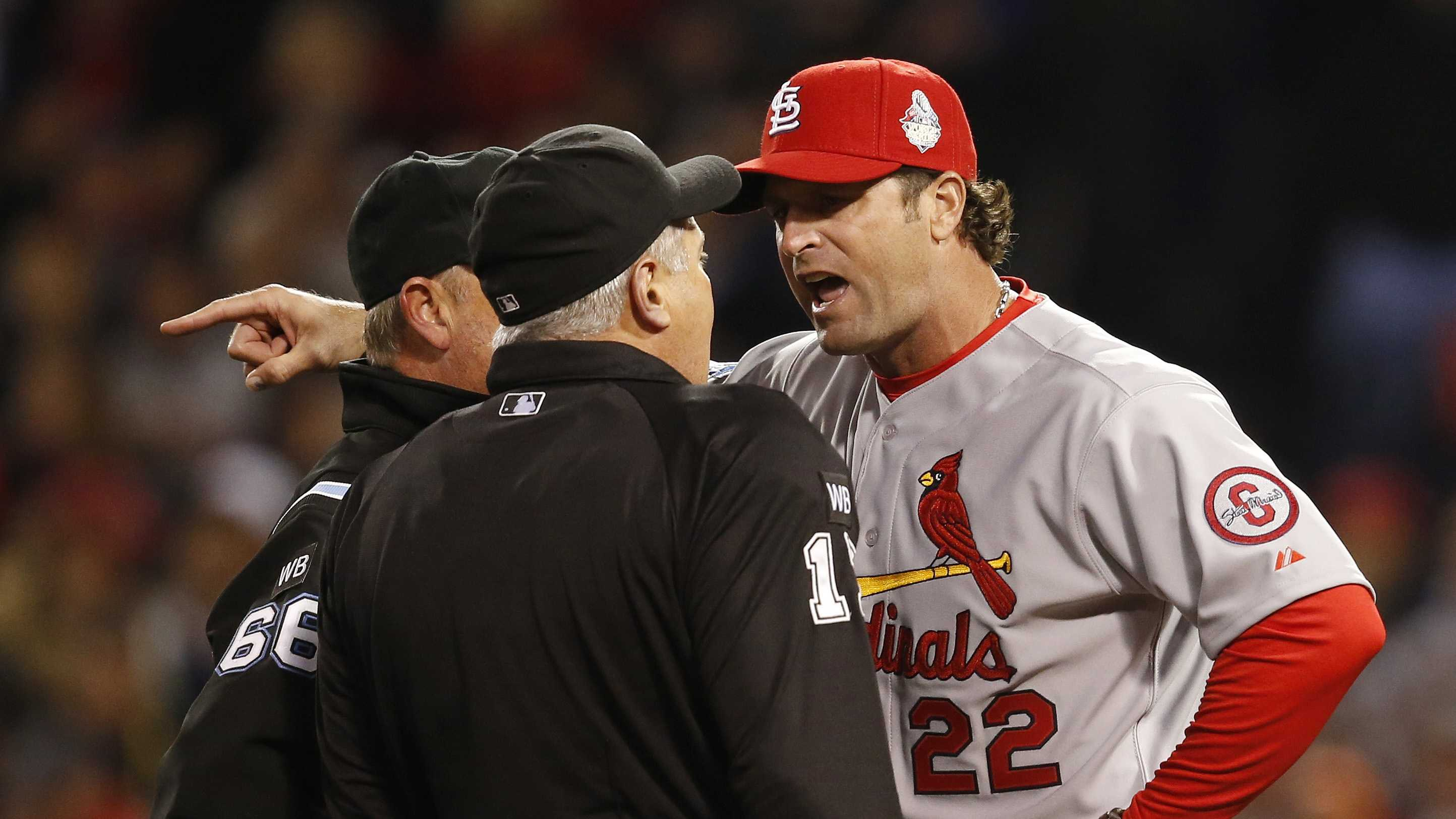 St. Louis Cardinals manager Mike Matheny argues a call during the first inning of Game 1 of baseball's World Series against the Boston Red Sox Wednesday, Oct. 23, 2013, in Boston.