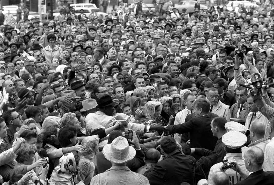 President Kennedy reaches out to the crowd gathered at the Hotel Texas Parking Lot Rally in Fort Worth, Texas, 22 November 1963.