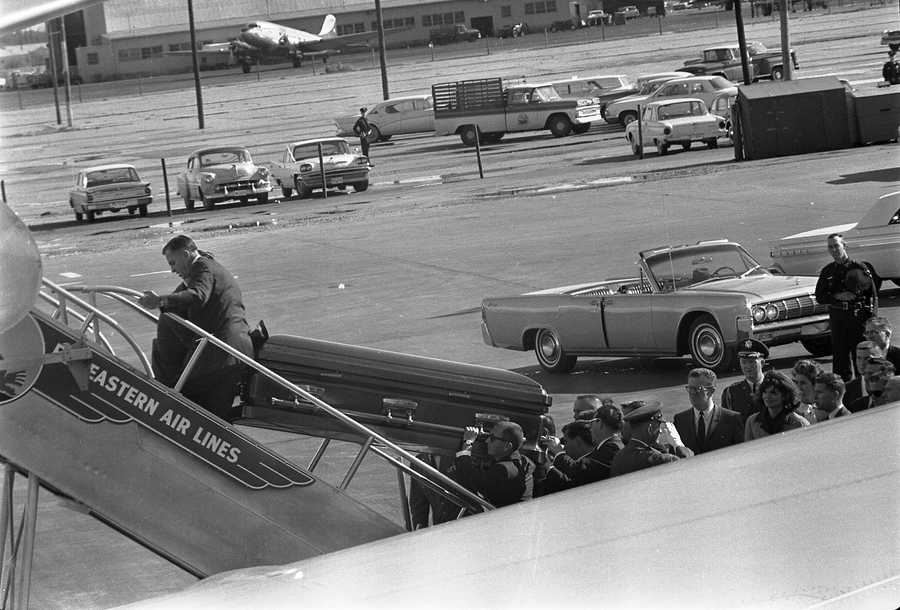 "President Kennedy's casket is loaded on to Air Force One at Love Field in Dallas, Texas, 22 November 1963.  Onlookers include Lawrence ""Larry"" O'Brien, Jacqueline Kennedy, and Dave Powers."