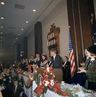 The head table at the Fort Worth Chamber of Commerce Breakfast, Hotel Texas, Fort Worth, Texas, 22 November 1963. (including, L-R): Nellie Connally, Governor John Connally, Lady Bird Johnson, Vice President Lyndon B. Johnson, First Lady Jacqueline Kennedy and President John F. Kennedy behind the lectern.