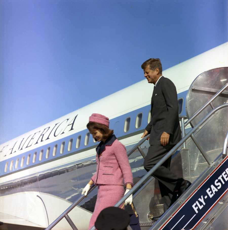 President and Mrs. Kennedy descend the stairs from Air Force One at Love Field in Dallas, Texas, 22 November 1963.