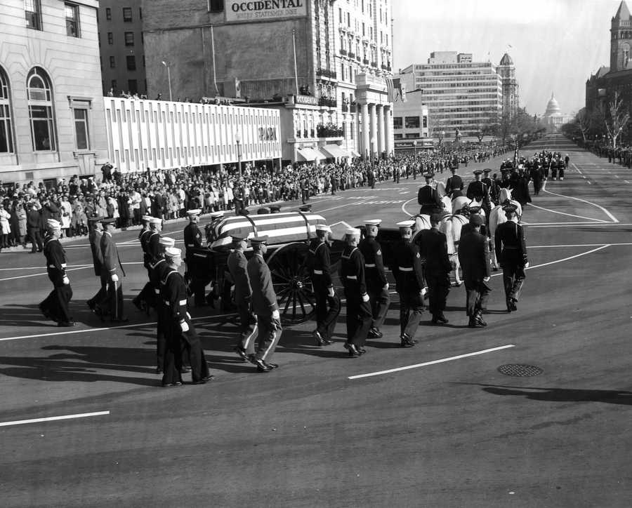 President Kennedy's body is borne from the White House to the U. S. Capitol, Washington, DC. 24 November 1965