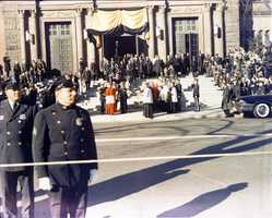 The body of the late President John F. Kennedy being carried from St. Matthews Cathedral. 25 November 1963