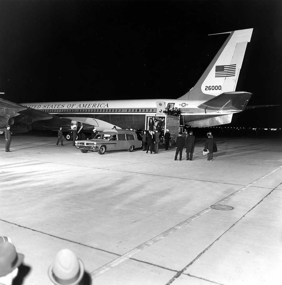 President Kennedy's remains return from Dallas and are unloaded from Air Force One into a Navy Ambulance as Attorney General Robert F. Kennedy, First Lady Jacqueline Kennedy, Special Assistant to the President Larry O'Brien, Secret Service Agent Clint Hill, and Naval Aide Tazewell Shepard and many others look on. Washington, DC, Andrews Air Force Base.