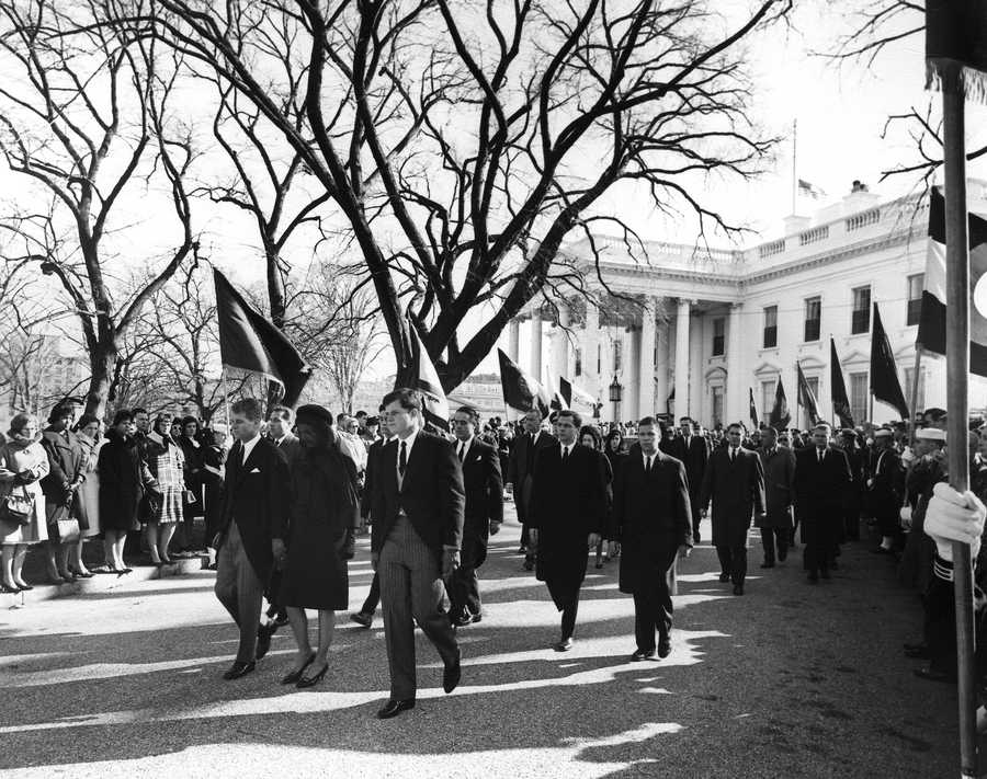 Procession from the White House to St. Matthew's Cathedral. First Row, L-R: Attorney General Robert F. Kennedy, Mrs. Jacqueline Kennedy, Senator Edward M. Kennedy&#x3B; Second Row, L-R: James Auchincloss, R. Sargent Shriver, Steven Smith&#x3B; Third Row, L-R: Mrs. Lady Bird Johnson, President Johnson, Luci Baines Johnson. Secret Service agents, mourners, others.