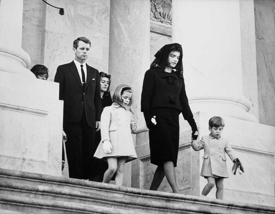 Kennedy family members leaving the funeral ceremony for President John F. Kennedy. Photograph includes: (L-R) Jean Smith, Robert F. Kennedy, Patricia Lawford, Caroline Kennedy, First Lady Jacqueline Kennedy, and John F. Kennedy, Jr. East Front Entrance of Capital Building, Washington, D.C. 24 November 1963