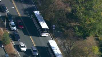The team boarded buses at the stadium Friday morning and received a police escort to Logan Airport.