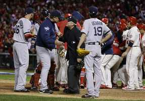 Boston Red Sox manager John Farrell argues with home plate umpire Dana DeMuth after St. Louis Cardinals scored the winning run on an obstruction play during the ninth inning of Game 3 of baseball's World Series Saturday, Oct. 26, 2013, in St. Louis. The Cardinals won 5-4 to take a 2-1 lead in the series.