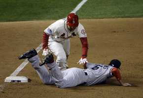 """Text of Major League Baseball's obstruction Rule 7.06.When obstruction occurs, the umpire shall call or signal """"Obstruction.""""(a) If a play is being made on the obstructed runner, or if the batter-runner is obstructed before he touches first base, the ball is dead and all runners shall advance, without liability to be put out, to the bases they would have reached, in the umpire's judgment, if there had been no obstruction. The obstructed runner shall be awarded at least one base beyond the base he had last legally touched before the obstruction. Any preceding runners, forced to advance by the award of bases as the penalty for obstruction, shall advance without liability to be put out.Rule 7.06(a) Comment: When a play is being made on an obstructed runner, the umpire shall signal obstruction in the same manner that he calls """"Time,"""" with both hands overhead. The ball is immediately dead when this signal is given&#x3B; however, should a thrown ball be in flight before the obstruction is called by the umpire, the runners are to be awarded such bases on wild throws as they would have been awarded had not obstruction occurred. On a play where a runner was trapped between second and third and obstructed by the third baseman going into third base while the throw is in flight from the shortstop, if such throw goes into the dugout the obstructed runner is to be awarded home base. Any other runners on base in this situation would also be awarded two bases from the base they last legally touched before obstruction was called."""