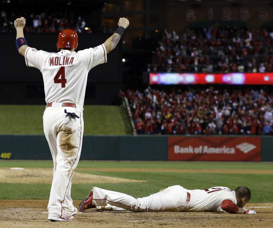 Allen Craig slid home and it sure looked as though he was out. Didn't matter.St. Louis Cardinals' Yadier Molina reacts as Allen Craig lays on home plate after getting tangled with Boston Red Sox's Will Middlebrooks.