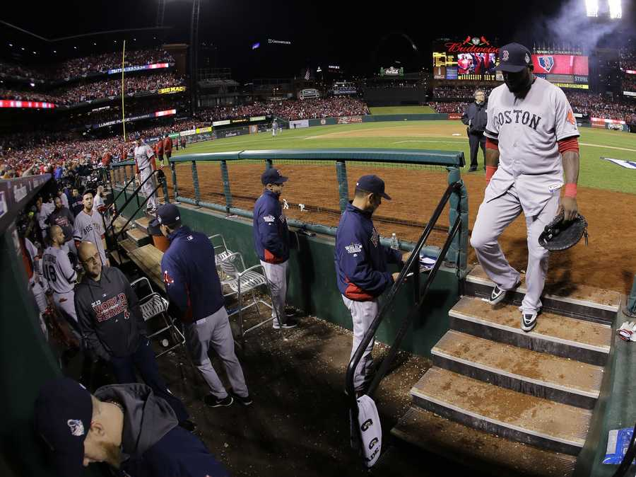 Boston Red Sox's David Ortiz walks off the field after St. Louis Cardinals defeated the Red Sox, 5-4, in Game 3 of baseball's World Series Saturday, Oct. 26, 2013, in St. Louis. St. Louis won the game on an obstruction call.