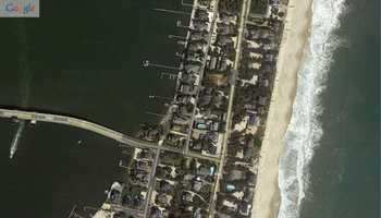 "Mantoloking, New Jersey. ""Before"" image captured by Google&#x3B; ""After"" image captured by NOAA's National Geodetic Survey."