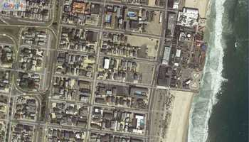 "Seaside Heights, New Jersey. ""Before"" image captured by Google&#x3B; ""After"" image captured by NOAA's National Geodetic Survey."