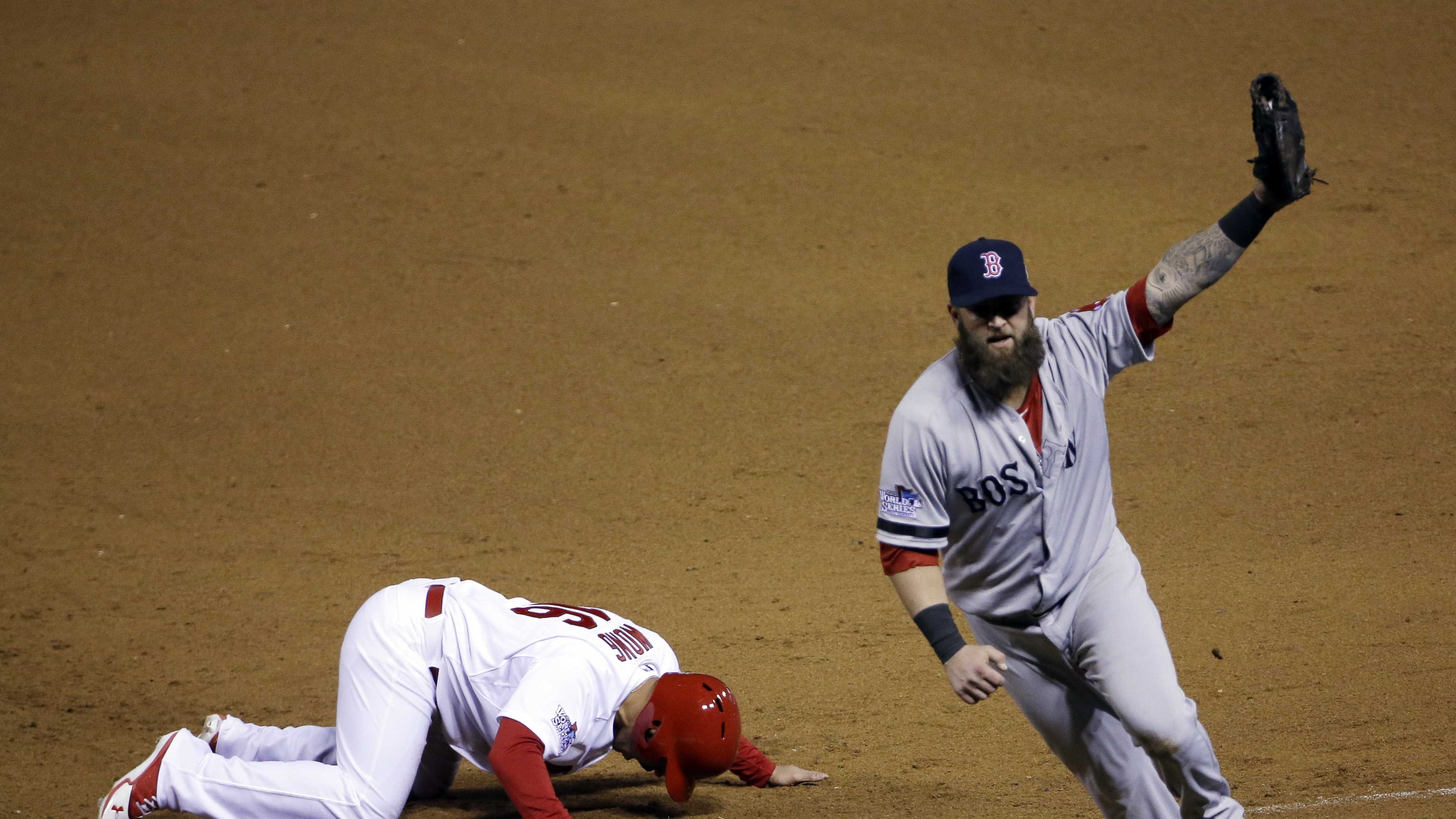 Boston Red Sox first baseman Mike Napoli celebrates after tagging out St. Louis Cardinals' Kolten Wong on a pick-off attempt to end Game 4 of baseball's World Series Sunday, Oct. 27, 2013, in St. Louis. The Red Sox won 4-2 to ties the series at 2-2.