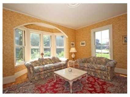 Traditional double parlor entry of yesteryear gives way to a stunning state of the art kitchen and family room.