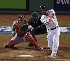 Boston Red Sox's Shane Victorino drives in 3 runs during the fourth inning of Game 6 of baseball's World Series against the St. Louis Cardinals Wednesday, Oct. 30, 2013, in Boston.
