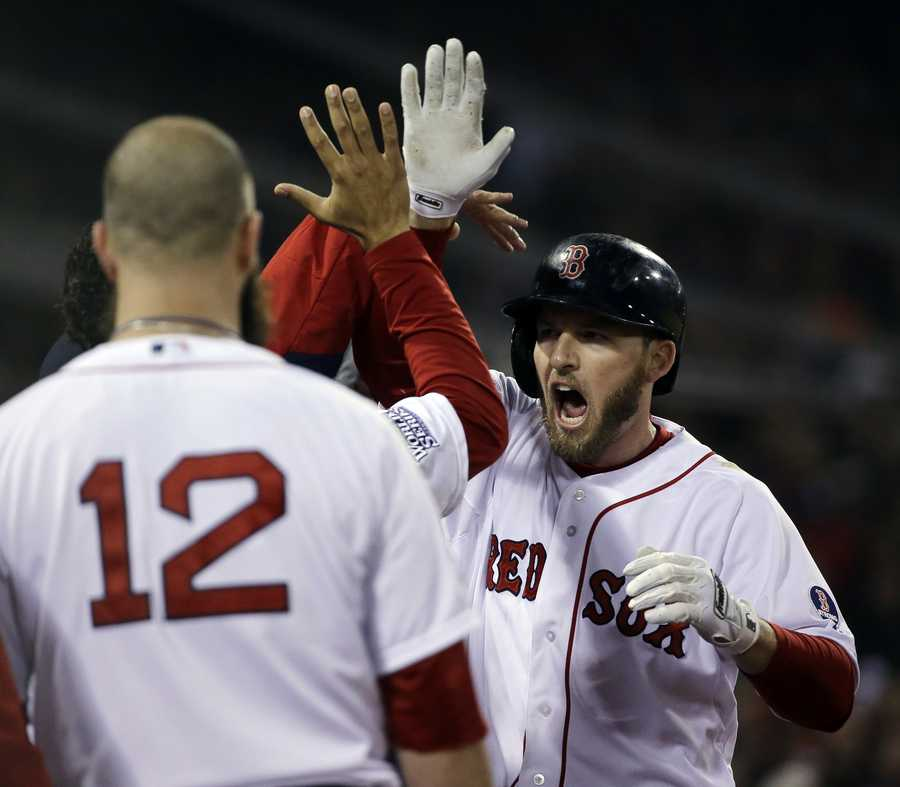Boston Red Sox's Stephen Drew is congratulated after hitting a home run during the fourth inning of Game 6 of baseball's World Series against the St. Louis Cardinals Wednesday, Oct. 30, 2013, in Boston.